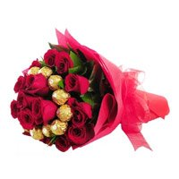 Diwali Chocolates Delivery to India comprising 16 pcs Ferrero Rocher and 24 Red Roses Bouquet
