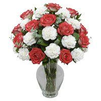 Send Flowers to Udupi and order for the best Red Rose White Carnation Vase 18 Flowers to Udupi