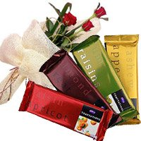 Place Online Order for Diwali Gifts to India. Deliver 4 Cadbury Temptation Chocolates With 3 Red Roses Flowers to India