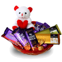 Send Diwali Gifts to India. Deliver Dairy Milk, Silk, Temptation Chocolates in India and 6 Inch Teddy Basket