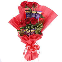 Get Father's Day Gifts to India for your loved ones. Send 16 Pcs Ferrero Rocher 24 Red White Roses Flowers Bouquets to Rajahmundry