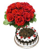Birthday Gifts to Modipuram. 1/2 Kg Black Forest Cake 12 Red Roses Bouquet Delivery in Modipuram