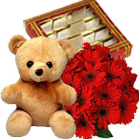 Send Flower Online to India. 12 Gerbera Bouquet, 1/2 Kg Kaju Burfi, 1 Teddy Bear on Rakhi