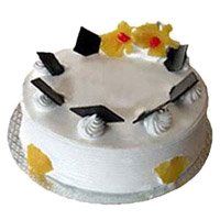 Cake Delivery in India to send 1 Kg Eggless Pineapple Cake From 5 Star Bakery