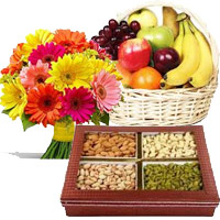 Gifts to Manipal. Online Delivery of 12 Mix Gerberas, 3 Kg Fresh Fruit Basket, 0.5 Kg Mixed Dry Fruits India for Diwali