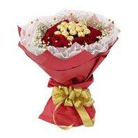 Online Diwali Gifts Delivery to India contains 16 Pcs Ferrero Rocher Chocolate encircled with 20 Red Roses Flowers