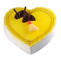 Order Cake Online India Midnight Delivery that includes 3 Kg Heart Shape Pineapple Cake