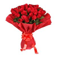 Flowers to Vizag. Deliver Red Rose Bouquet in Crepe 50 Flowers in Vizag