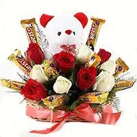 Father's Day chocolates to India. Send 36 Red White Roses with 16 Pcs Ferrero Rocher Bouquets to Vijyawada
