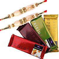 Send Rakhi Flowers to India. Order for 4 Cadbury Temptation Chocolates With 3 Red Roses Flowers to India India